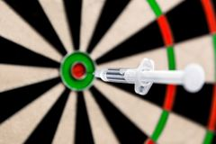 Syringe put in a dartboard bullseye centre, concept success and pharmacy or health care royalty free stock photos