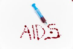 Syringe of Red Blood Test for research HIV AIDS Concept Idea Stock Image