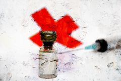 Syringe and red cross Royalty Free Stock Photo