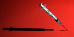 Syringe with shadow Stock Image
