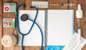 Syringe, stethoscope, blank page notepad, bandage, pill, elastic bandage and gloves on the doctor table. Medical diagnosis or royalty free stock photography