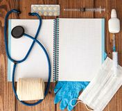 Syringe, stethoscope, blank page notepad, bandage, pill, elastic bandage and gloves on the doctor table. Medical diagnosis or. Doctor prescription mockup royalty free stock photography