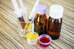 Syringe with syrup medicine and pill use to feed for kids. Stock Photography