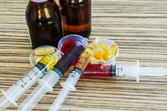 Syringe with syrup medicine and pill use to feed for kids. Royalty Free Stock Photography