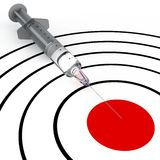 Syringe and target Stock Photos