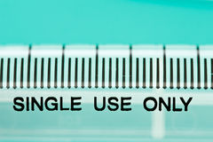 Syringe and words 'single use only' Royalty Free Stock Photography