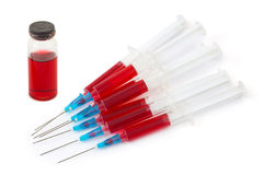 Syringes and bottle Stock Photo