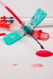 Syringes and IV Lines Covered with Blood Royalty Free Stock Image