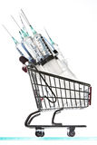 Syringes and a miniature shopping cart Stock Photography