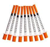 Syringes with orange caps isolated. Injections Royalty Free Stock Images