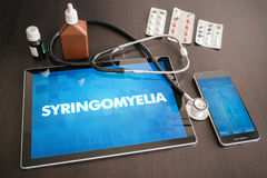 Syringomyelia (neurological disorder) diagnosis medical concept. On tablet screen with stethoscope royalty free stock photography
