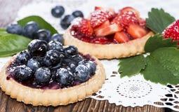 Syrliga blåbär och jordgubbe Royaltyfri Bild