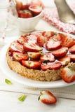 Syrliga jordgubbe och mandel Fotografering för Bildbyråer