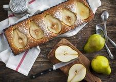 Syrliga päron och mandel Arkivfoto
