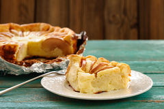 Syrnik, homemade quark pie with apples on old wooden table Royalty Free Stock Photo