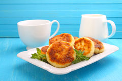 Syrniki (Cottage cheese pancakes, Fritters of cottage cheese) Royalty Free Stock Photo