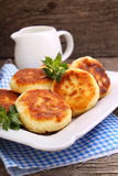 Syrniki (Cottage cheese pancakes, Fritters of cottage cheese) Stock Image