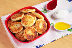 Syrniki. Cottage cheese pancakes. Royalty Free Stock Image