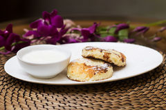 Syrniki, traditional Ukrainian and Russian cuisine. Cheese fritters with sour cream Royalty Free Stock Photos