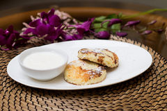 Syrniki, traditional Ukrainian and Russian cuisine. Cheese fritters with sour cream Royalty Free Stock Image