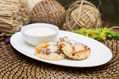 Syrniki, traditional Ukrainian and Russian cuisine. Cheese fritters with sour cream Stock Image