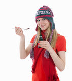 Syrup being filled by young woman in knitted cap Stock Photo