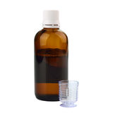 Syrup in a bottle with dosage cup Royalty Free Stock Images