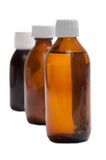 Syrup bottles Royalty Free Stock Images