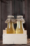 Syrup. Bottles with homemade syrup. Can be used as a photo of various kinds of syrup or lemonade Stock Images
