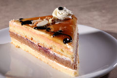 Syrup cream and chocolate on coffee cake slice Royalty Free Stock Image