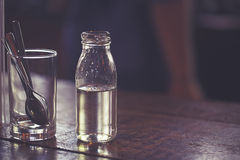 Syrup in glass bottle Royalty Free Stock Photography