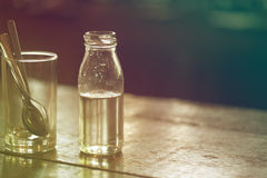 Syrup in glass bottle Royalty Free Stock Photos