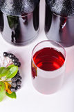 Syrup made from aronia, berries, glass and bottles Stock Images