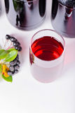 Syrup made from aronia, glass and bottles Royalty Free Stock Photos