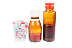 Syrup Medication Bottles and Medicine in Spoons Stock Image