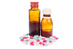 Syrup Medication Bottles and Medicine in Spoons Stock Images