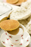 Syrup waffle on teacup showing tea Stock Photo