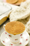 Syrup waffle on teacup vertical Royalty Free Stock Image