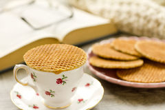 Syrup waffle warming on top of a teacup Stock Photos