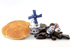 Syrup waffles and licorice candies. Traditional dutch syrup waffles and licorice candies with delftware isolated on white background Stock Photos