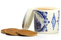 Syrup waffles. Traditional dutch syrup waffles in a delftware container on white background Stock Images