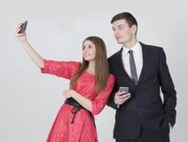 Syskongrupp som tar selfie Arkivbild
