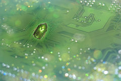 System bug. A nicely shimmering bug, in real greenish color, in front of a motherboard, showing a system error, through this picture royalty free stock photos