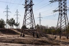System of electricity pylons and power lines out-of-town Stock Photography