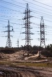 System of electricity pylons and power lines out-of-town Stock Images