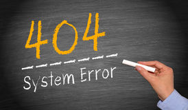 404 System Error. Female hand with chalk writing text on blackboard Stock Image