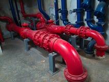 System för pump för sugtitelradhjälpmotor från höjd som buiding Arkivfoto