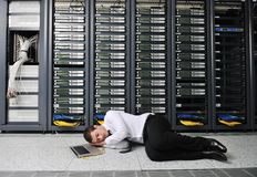 System fail situation in network server room. Business man in network server room have problems and looking for  disaster solution Stock Photography