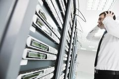 System fail situation in network server room. Business man in network server room have problems and looking for  disaster solution Stock Images