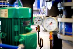 System of hot water pipes with manometer in boiler room.  stock photo